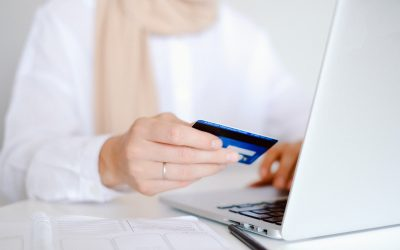person-in-white-long-sleeve-shirt-holding-credit-card-4482896-400x250